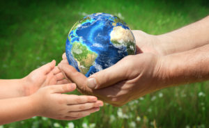 AdobeStock 170021405 300x184 - The man gives planet Earth to baby. Ecology concept. Elements of this image furnished by NASA