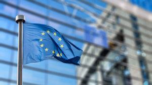 AdobeStock 93494284 300x169 - European Union flag against European Parliament